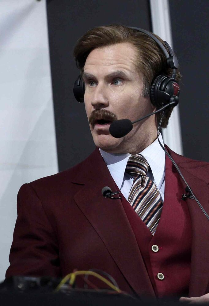 Ron Burgundy gets down to business as curlers start throwing stones. (Mike Deal / Winnipeg Free Press)