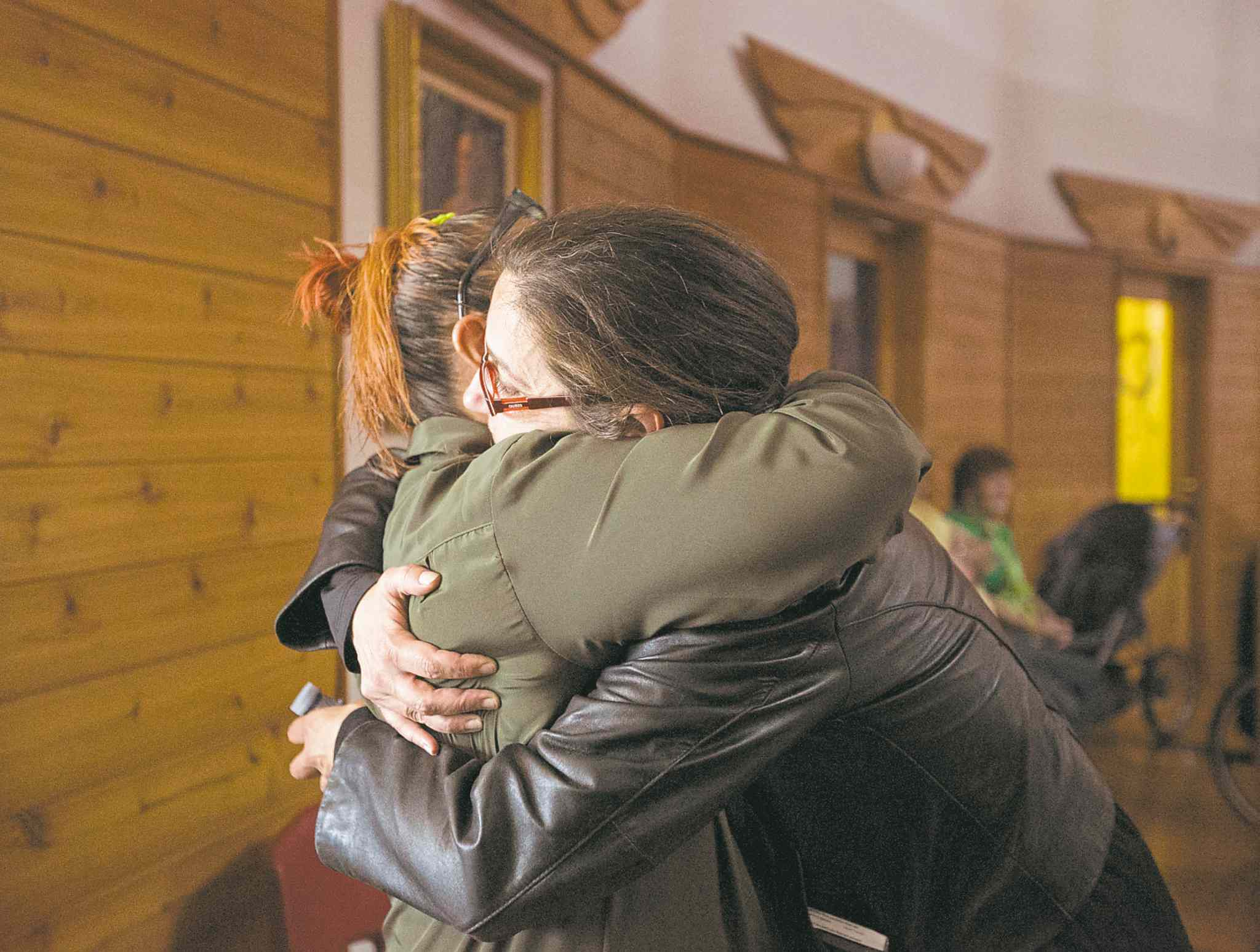 Lorraine Clemens hugs friend Rebecca  Murdock following  the walk.