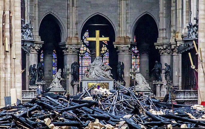 Debris inside Notre Dame cathedral in Paris. (Christophe Petit Tesson / The Associated Press)