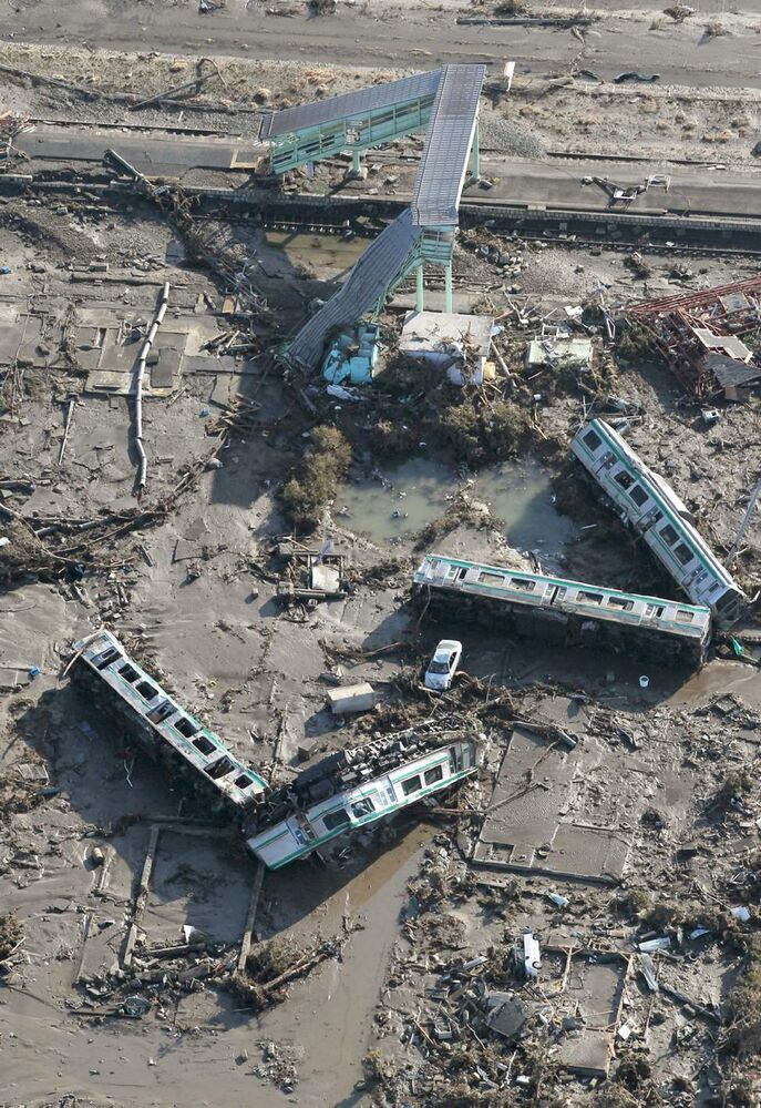 Cars of a train lie overturned in Shinchi town, Fukushima prefecture, Saturday, March 12, 2011 after being washed away by an earthquake-triggered tsunami. The powerful tsunami created by one of the strongest earthquakes ever recorded swept away Japan's east coast Friday. (AP Photo/Kyodo News)