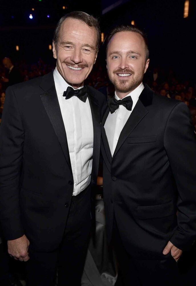 Bryan Cranston and Aaron Paul pose at the 66th Primetime Emmy Awards. Both went home with hardware for Breaking Bad. (John Shearer/Invision for the Television Academy/ The Associated Press)