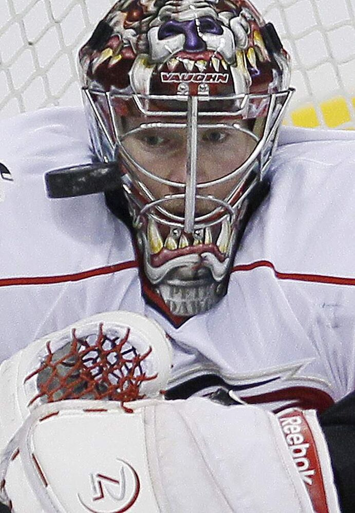 Carolina Hurricanes goaltender Justin Peters keeps his eye on the puck.
