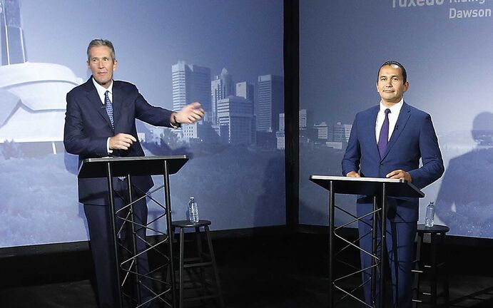 Liberal Party of Manitoba leader Dougald Lamont, left to right, Progressive Conservative leader and Manitoba Premier Brian Pallister, NDP leader Wab Kinew and Green Party of Manitoba leader James Beddome prepare for a leaders' debate at CBC in Winnipeg, Wednesday, August 28, 2019. Manitobans go to the polls Sept. 10. THE CANADIAN PRESS/John Woods