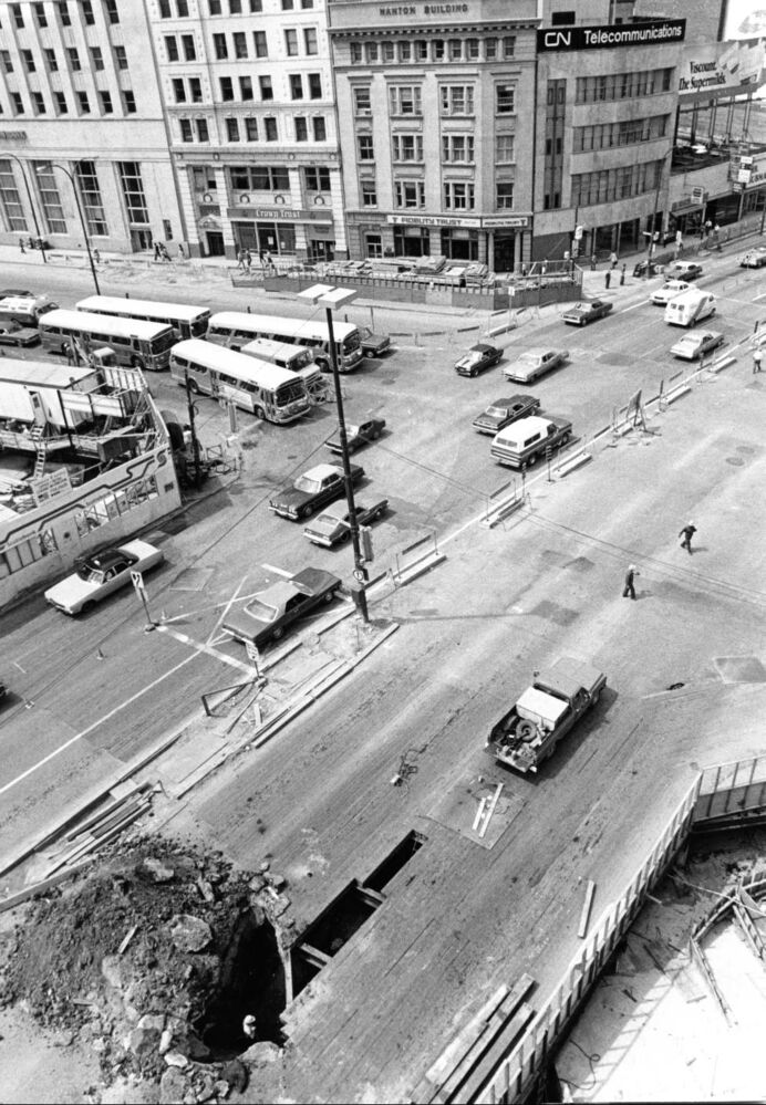 City crews begin street pavement reconstruction in the Portage Avenue and Main Street area, May 30, 1978. Work included putting in new pavement, replacing existing sidewalks with interlocking paving stone walks and upgrading street lighting on Main Street from Graham Avenue to Lombard Avenue and on Portage Avenue from Fort Street to about 150 feet east of Main. (Wayne Glowacki / Winnipeg Free Press Archives)