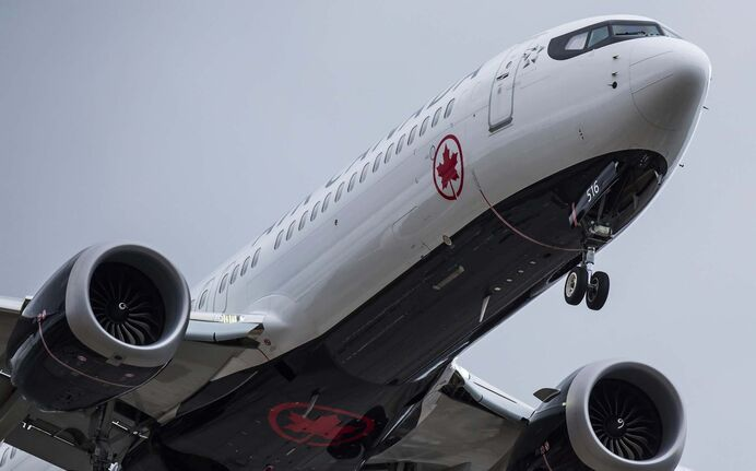 An Air Canada Boeing 737 Max aircraft arriving from Toronto prepares to land at Vancouver International Airport in Richmond, B.C., on Tuesday, March 12, 2019. Air Canada cancelled London-bound flights from Halifax and St. John's Tuesday and Wednesday after the United Kingdom banned all Boeing Max 8 jets in its airspace. (Darryl Dyck / The Canadian Press)</p>