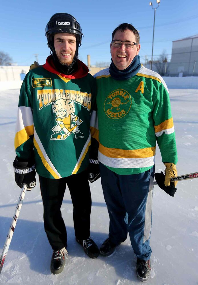 Tumbleweeds Jacob McMahon and his father Tom McMahon share a smile following their game against the Mighty Puckin' Drunks. (Trevor Hagan / Winnipeg Free Press)