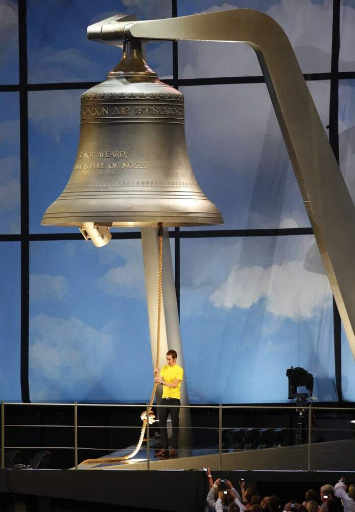 British cyclist Bradley Wiggins rings the Olympic Bell during the Opening Ceremony at the 2012 Summer Olympics, Friday, July 27, 2012, in London.