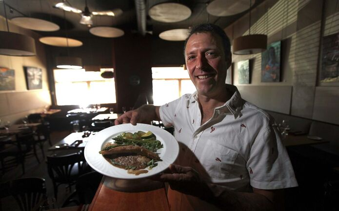 Owner Joel Boulet shows off the fried pickerel. (Phil Hossack / Winnipeg Free Press)