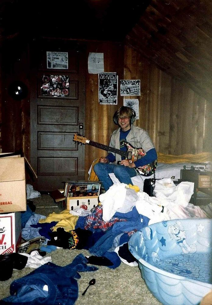 A young Kurt Cobain plays guitar in his childhood home in Aberdeen, Wash. (Kim Cobain)
