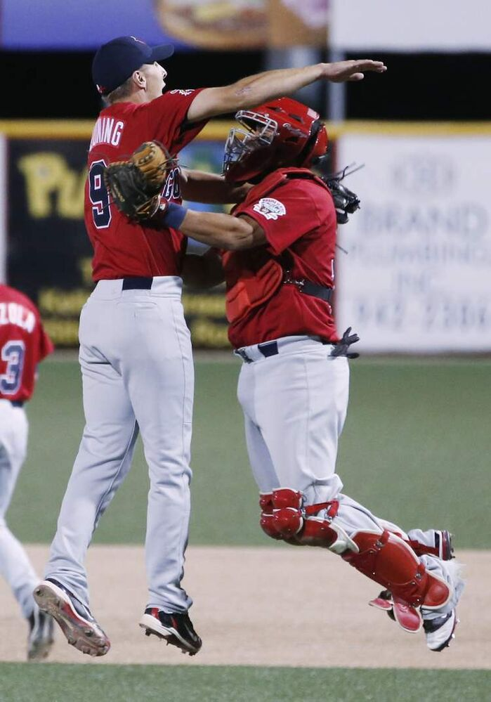 Winnipeg Goldeyes pitcher Brian Beuning, left, celebrates with catcher Luis Alen after defeating the Wichita Wingnuts 8-3 in Wichita, Kansas Friday night.  (Fernando Salazar / The Wichita Eagle)