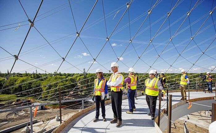 Margaret Redmond (left), President and CEO of Assiniboine Park Conservancy and Hartley Richardson (second left), President and CEO James Richardson & Sons Limited takes in the view from the canopy walkway during construction of Canada's Diversity Gardens at Assiniboine Park Tuesday morning.