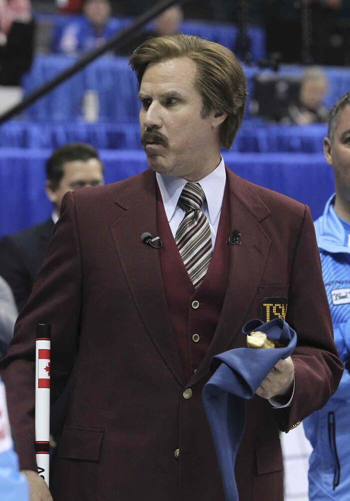 Ron Burgundy cradles a doughnut at Roar of the Rings. (Mike Deal / Winnipeg Free Press)