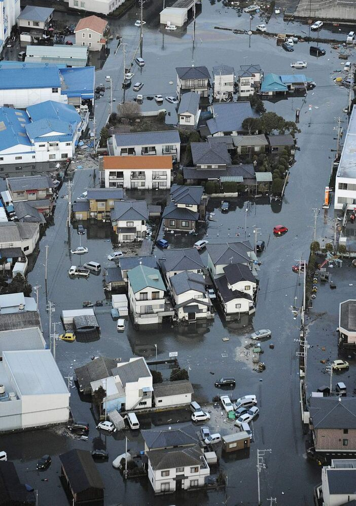Oarai town is submerged after a tsunami in Ibaraki prefecture (state), Japan, Friday, March 11, 2011. The tsunami spawned by the largest earthquake in Japan's recorded history slammed the eastern coast Friday, sweeping away boats, cars, homes and people. (AP Photo/Kyodo News)