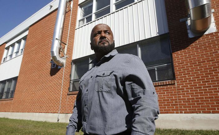 JOHN WOODS / WINNIPEG FREE PRESSAbe Araya, CUPE Manitoba president and former WSD maintenance staffer for 20 years, is photographed in front of ventilation stacks st Elmwood High School in Winnipeg Wednesday, August 12, 2020. Araya is concerned that school ventilation systems are not up to COVID-19 standards.</p><p>Reporter: Macintosh</p>