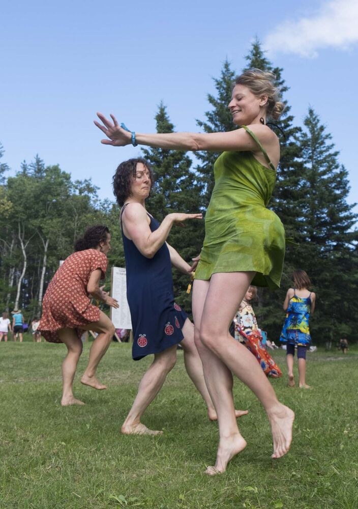 ZACHARY PRONG / WINNIPEG FREE PRESS</p></p><p>From right to left, Roxie, Kat and Judy dance at Folkfest on Friday.</p>