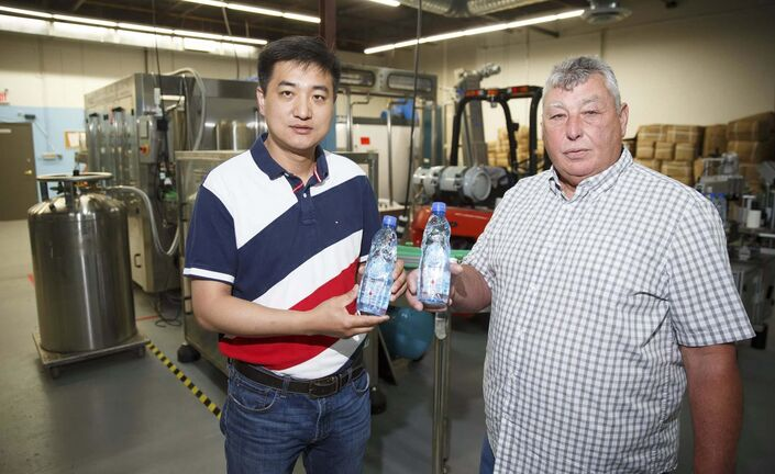 (Mike Deal / Winnipeg Free Press)</p><p>Owner John Fu, left and consultant Rene Lamoureux in their new bottling facility on Airport Road.</p>