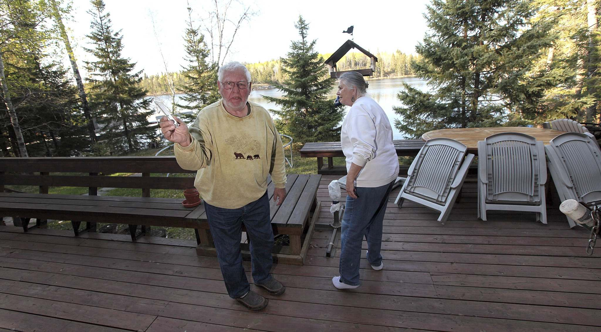 PHIL HOSSACK / WINNIPEG FREE PRESS</p><p>Hardy and Elke May check out their Caddy Lake cottage for damage after returning Tuesday, finding none except a broken piece of a sprinkler the local fire department had already taken down from their rooftop.</p>