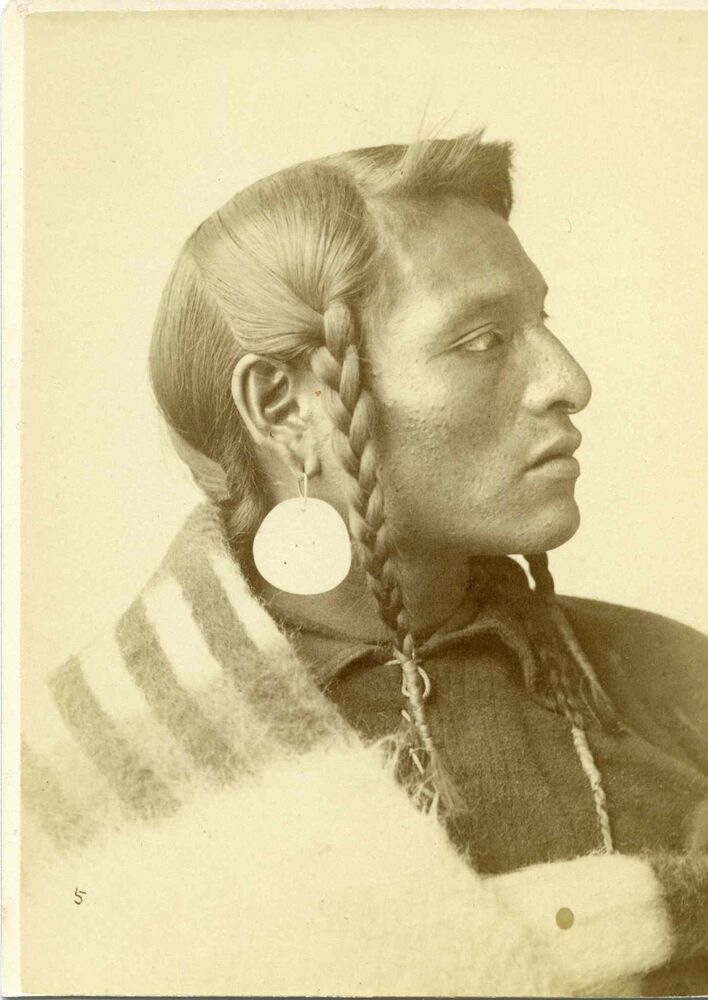Portrait of a young Indigenous man in traditional clothing (UNIVERSITY OF MANITOBA ARCHIVES AND SPECIAL COLLECTIONS)