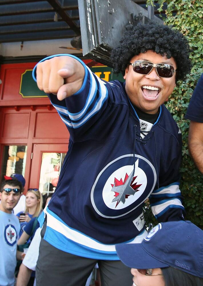 Winnipeg Jets fans have a blast outside the Jobing.com Arena in Phoenix, Arizona Saturday prior to the start of the NHL game between the Winnipeg Jets and the Phoenix Coyotes.   (JOE BRYKSA / WINNIPEG FREE PRESS)