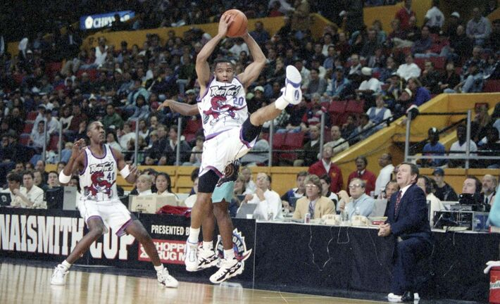 Raptors point guard Damon Stoudamire grabs a rebound.