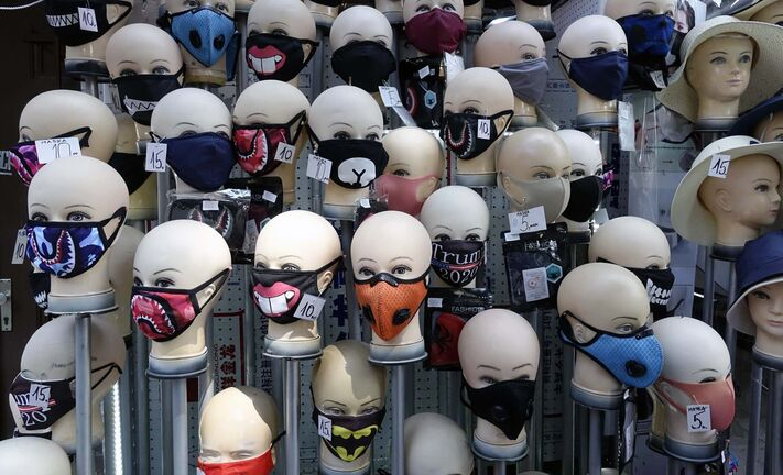 Masks placed on mannequins heads are displayed outside a shop in Sarajevo's main street, Bosnia, Monday, July 27, 2020. Regional WHO office in Bosnia expressed its concern with recent reports that medical institutions around the country are closing to maximum capacity as recent spike in COVID-19 infections are reaching record levels. (AP Photo/Eldar Emric)</p>