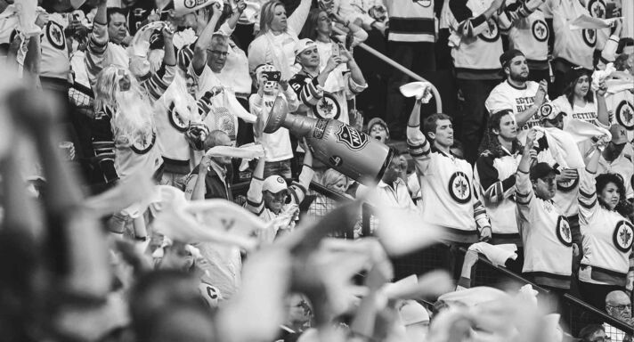 Fans cheer after the Winnipeg Jets score their second goal of the game in the second period.