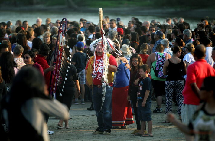 Grand Chief Derek Nepinak waits to led a procession from a vigil at the Alexander Docks in memory of Faron Hall and Tina Fontaine whose bodies were pulled from the Red River Sunday.