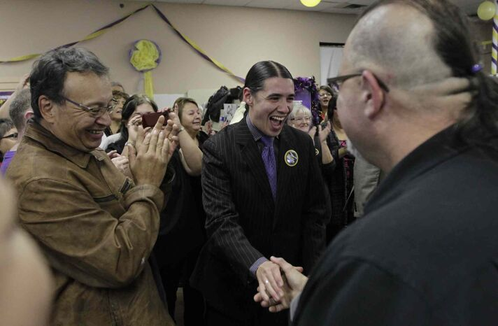 Mayoral candidate Robert-Falcon Ouellette is greeted by his supporters as he arrives at his HQ on election night.