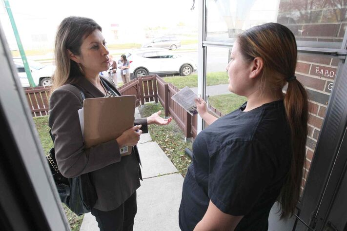 Point Douglas council candidate Rebecca Chartrand talks to resident Kirstin Rominuk. Chartrand had encouraged other indigenous people to run for office, only to receive the same urging.