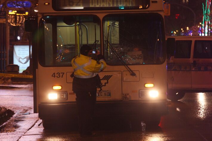 Winnipeg Police and Transit officials attend the scene at Carlton and Portage Ave where a city bus struck a pedestrian on Dec. 12.