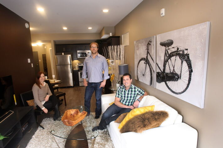 Kate Kennedy (from left), Rob Robson and Geoff Milnes of Progressive Real Estate in their block at 320 Stradbrook Ave.