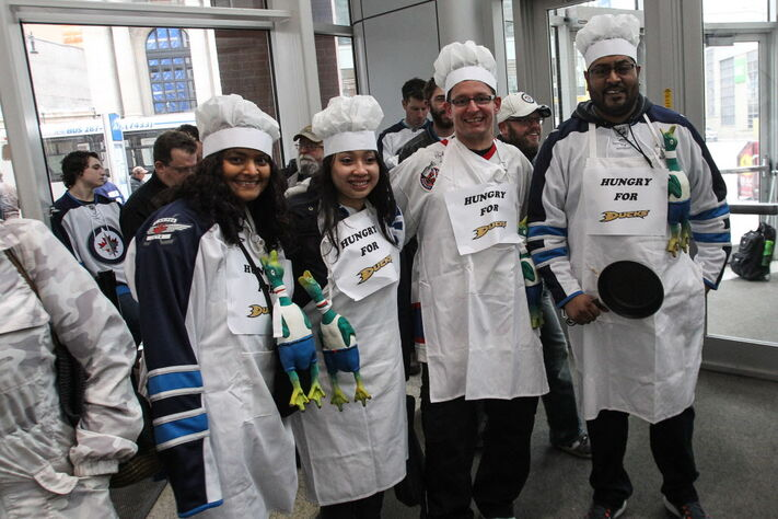 Melissa Hosein (from left), Kim Nguyen, Joseph Maksymowicz and Rahim Hosein dressed as chefs arrive prior the to third game of the Stanley Cup playoff series.