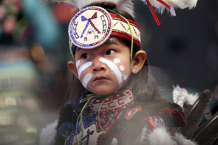 Five-year-old Blaze Standingready dances in his traditional regalia while in competition among hundreds of other indigenous dancers at MTS Centre. The annual Manito ahbee festival continues Sunday.