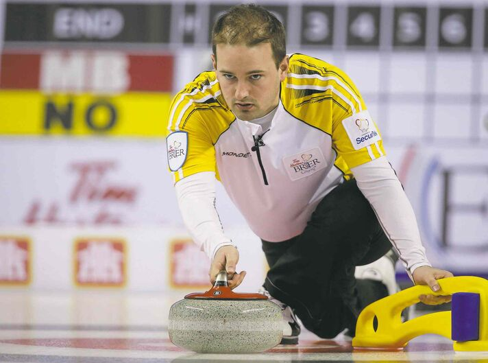 Manitoba skip Reid Carruthers delivers a rock during a 7-2 loss to Northern Ontario Tuesday night.