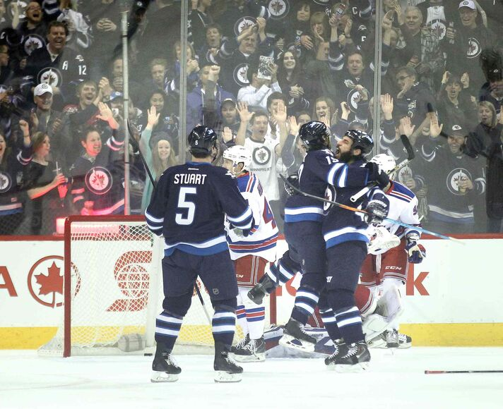 Winnipeg Jets Jim Slater and Chris Thorburn embrace after Slater's opening goal early in the first period against the New York Rangers Tuesday.