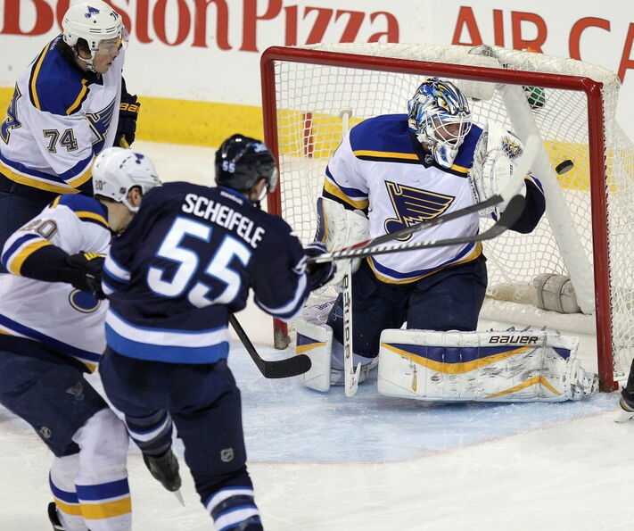 Mark Scheifele ties the game 1-1 with this quick shot past Brian Elliot in the third period Thursday night.