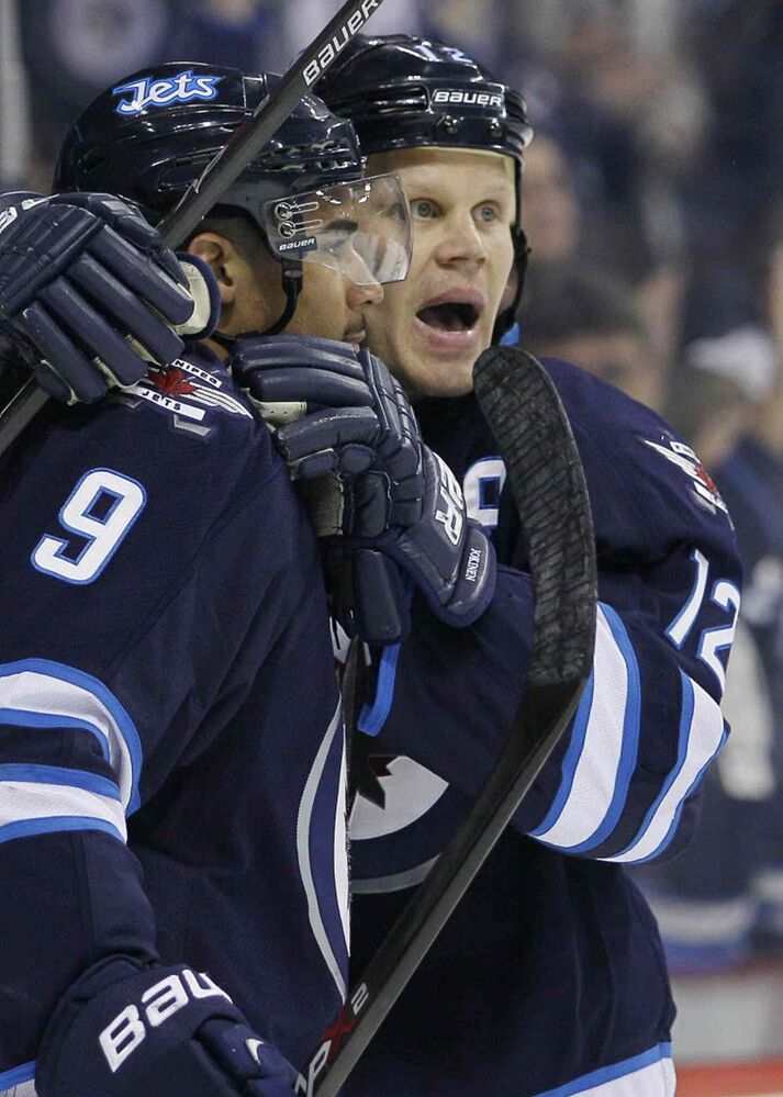 Winnipeg Jets' Olli Jokinen (12) and Evander Kane (9) celebrate Jokinen's goal during the second period on Thursday. (John Woods / The Canadian Press)