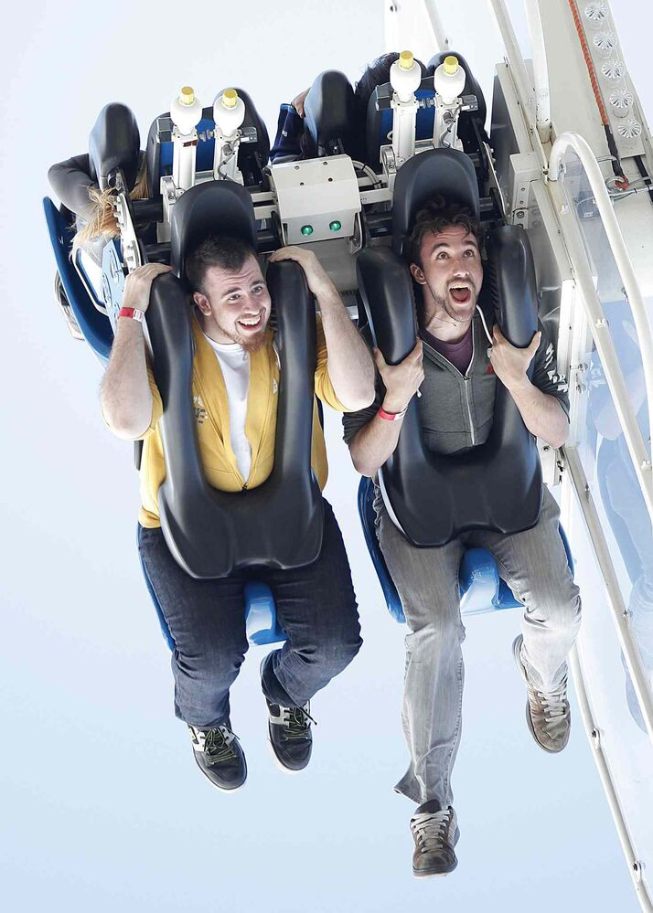 James Greenburgh, left, and Ian Moran on take a ride on Mach 3 at The Ex on Tuesday.  (John Woods/ Winnipeg Free Press)