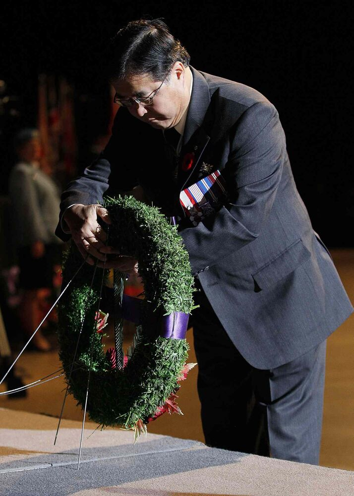Manitoba Lt.-Gov. Philip Lee lays a wreath at the Remembrance Day service at the RBC Convention Centre Winnipeg. (JOHN WOODS / THE CANADIAN PRESS)