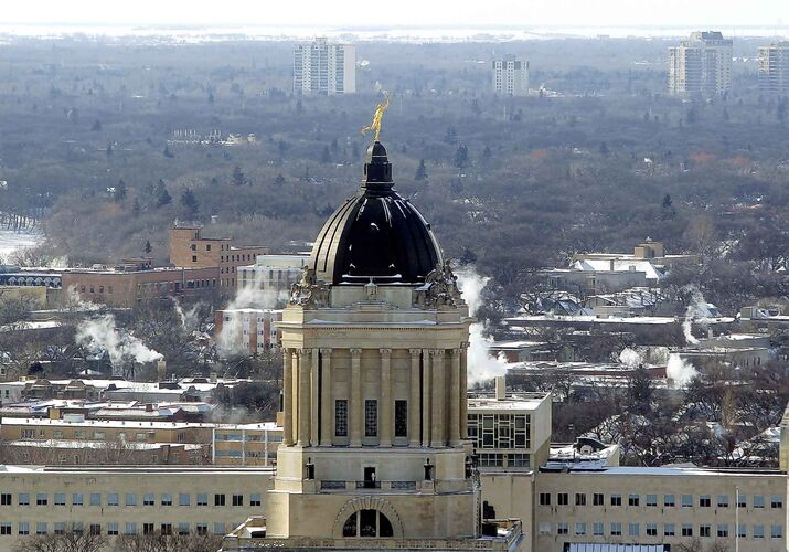 BORIS MINKEVICH / WINNIPEG FREE PRESS  Photos of the city taken from the Prairie 360 restaurant, formerly known as Revolving Restaurant (Fort Garry Place/Garry Street). The Golden Boy on the top of the The Manitoba Legislative Building. Feb. 8, 2017