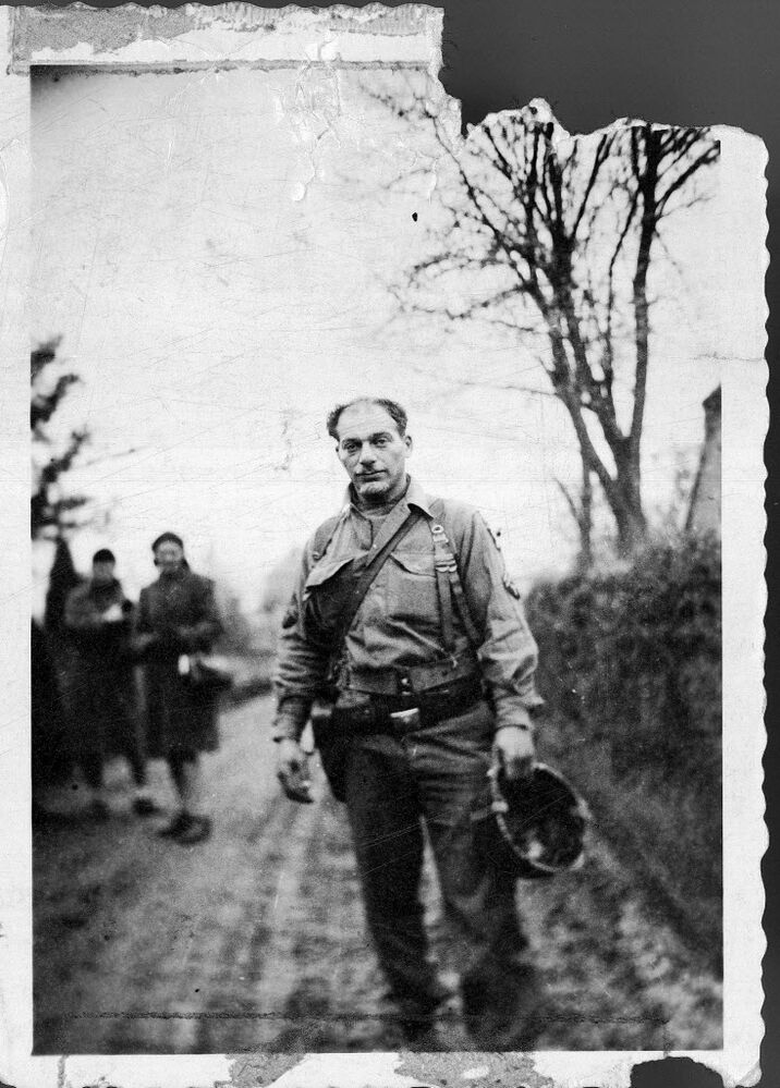 This 1944 photo provided by Beth J. Harpaz, shows her father, David Jackendoff, while serving with the 101st Airborne Division in Europe. Jackendoff parachuted into Normandy with the 101st Airborne on D-Day, and later fought in Holland and Belgium. Though he died in 1993, wartime radio interviews with him and a TV interview of the 40th anniversary of D-Day preserved his stories.  (Courtesy of Beth J. Harpaz / The Associated Press )
