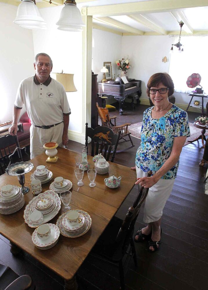 Walter Mueller  (left)and his wife Bette pose inside the old house that was moved to the site. (Boris Minkevich / Winnipeg Free Press)