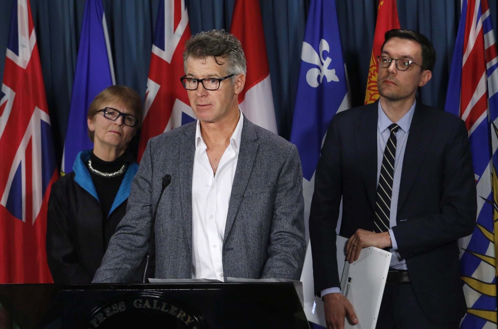 PATRICK DOYLE / THE CANADIAN PRESS FILES</p><p>Price Carter, son of Kay Carter, speaks at a news conference on Bill C-14, while his sister, Lee Carter, and Josh Paterson, executive director of the B.C. Civil Liberties Association, listen on Parliament Hill in April.</p>