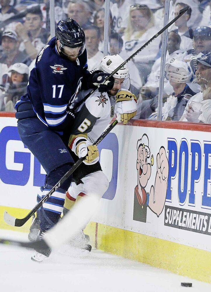 JOHN WOODS / THE CANADIAN PRESS</p><p>Winnipeg Jets' Adam Lowry (17) checks Vegas Golden Knights' Colin Miller (6) during second period of game one action in the NHL Western Conference Final in Winnipeg on Saturday, May 12, 2018.</p>