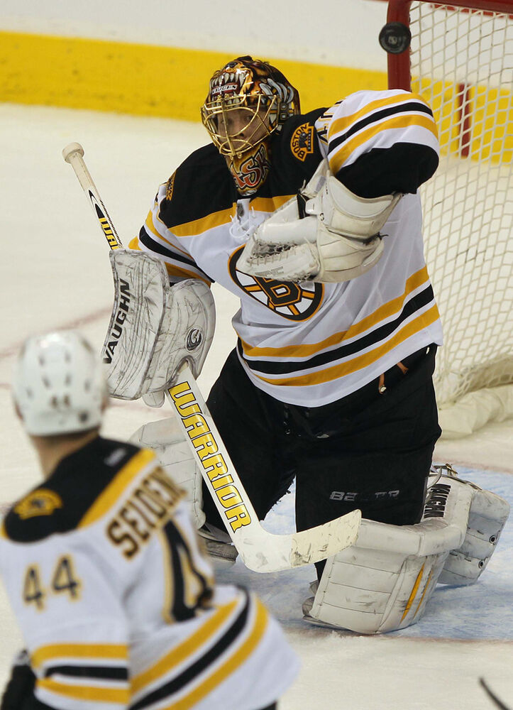 The puck flies towards Boston goaltender Tuukka Rask after a strong shot by Jets Andrew Ladd (not pictured) late in the third period. (JOE BRYKSA / WINNIPEG FREE PRESS)