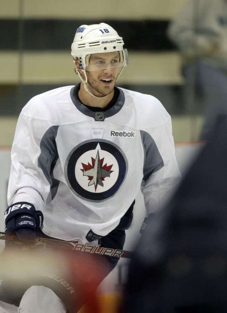 Forward Bryan Little and the Winnipeg Jets agreed to a five-year, $23.5-million contract in July. (Wayne Glowacki / Winnipeg Free Press)
