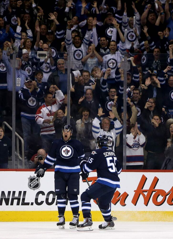 Winnipeg Jets' Devin Setoguchi (40) and Mark Scheifele (55) celebrate a third period goal against the Los Angeles Kings' during the third period.