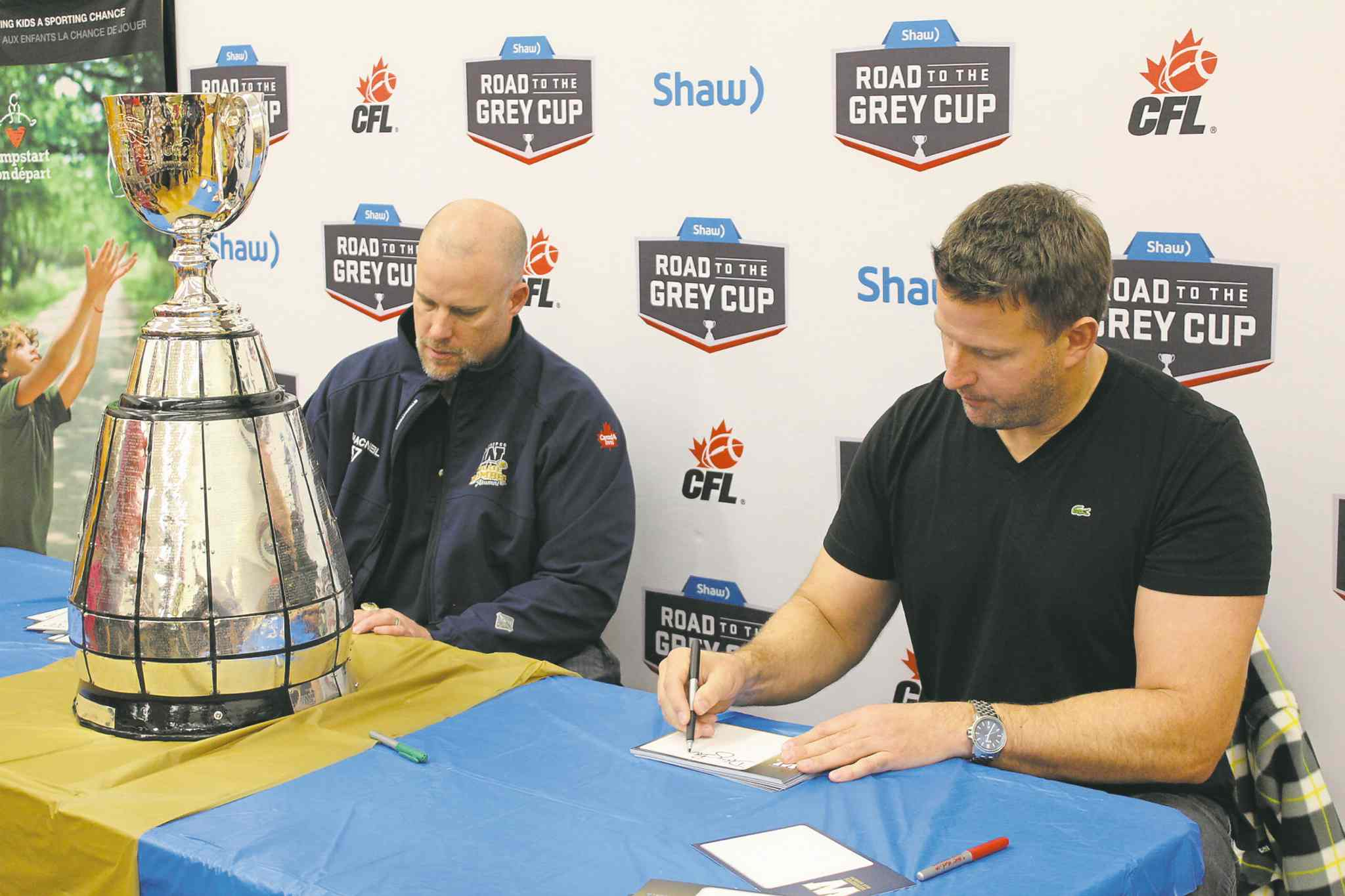 Brett MacNeil (left) and Doug Brown are on tour to promote the 103rd Grey Cup game.