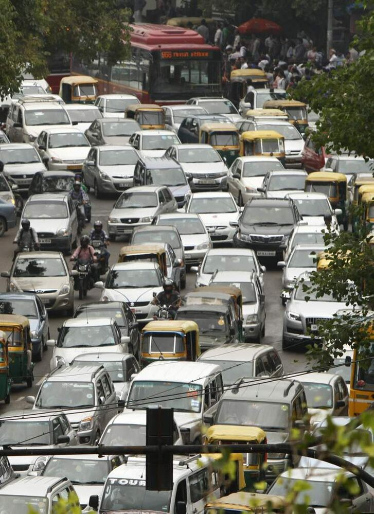 A road is packed in heavy traffics following power outage and rains in the central part of New Delhi, India, Tuesday, July 31, 2012. India's energy crisis spread�over half the country Tuesday when both its eastern and northern electricity grids�collapsed, leaving 600 million people without power in one of the world's biggest-ever blackouts. Traffic lights went out across New Delhi. (AP Photo/Rajesh Kumar Singh)