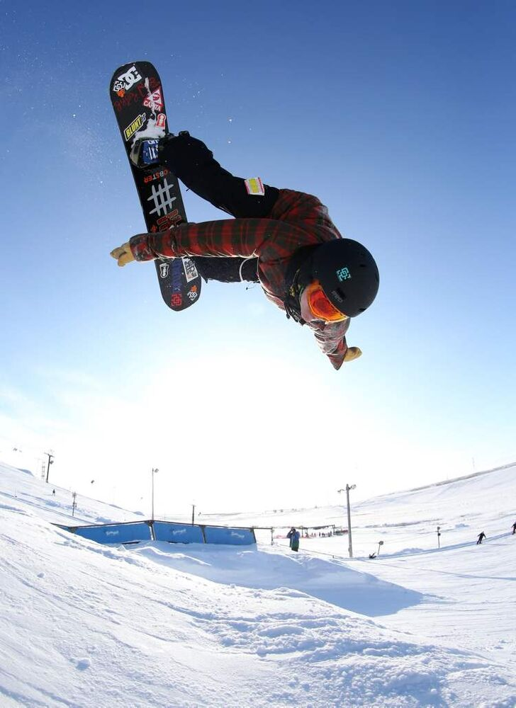 Eason Cerasani backflips over a tabletop jump. (TREVOR HAGAN/ WINNIPEG FREE PRESS)